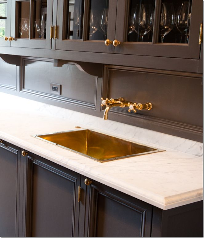 Butler's pantry... marble countertop, brass sink, and dark paint.