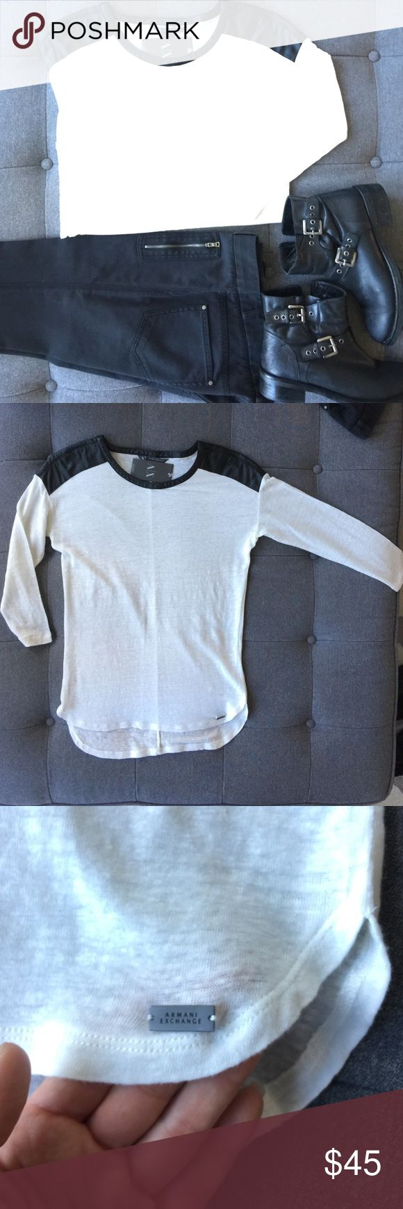 Armani Exchange Baseball T-Shirt Off white with faux leather shoulders and neck trim. Style is like baseball jersey. 3/4 sleeves, longer in the back. Slim fit. Gorgeous with jeans or leggings. Never worn. I also have one in grey for sale. See listings. A/X Armani Exchange Tops Tees - Long Sleeve