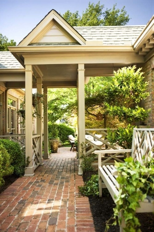This is what I need!  A covered walkway between the house and garage. Love the brick pavers too!