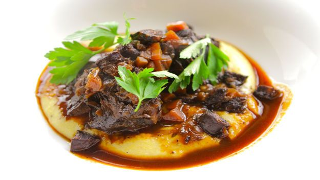 Simon Rimmer's rich slow-cooked beef cheeks are cooked in red wine and served with luxurious, creamy polenta for an impressive dinner party dish. #polenta #recipe