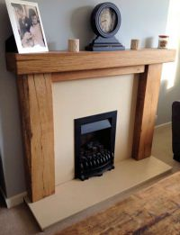 Gorgeous oak fire surround - particularly love the contrast with the black fire