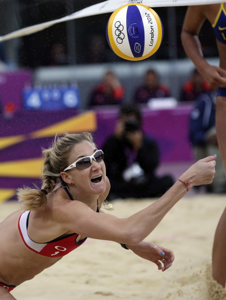 Kerri Walsh Jennings of the United States digs out a ball during a women's semi-final beach volleyball match at the 2012 Summer Olympics, Tuesday, Aug. 7, 2012, in London.