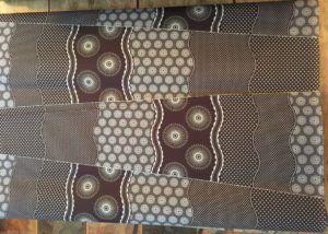Shweshwe Chocolate & Red | Meerkat Shweshwe Fabrics