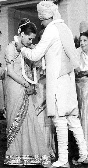 Rajiv Gandhi puts a garland of fresh flowers on his bride Sonia