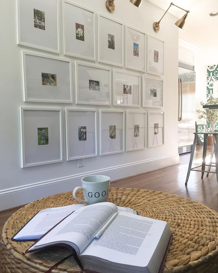family gallery wall, white frames, kitchen, woven ottoman, library sconces