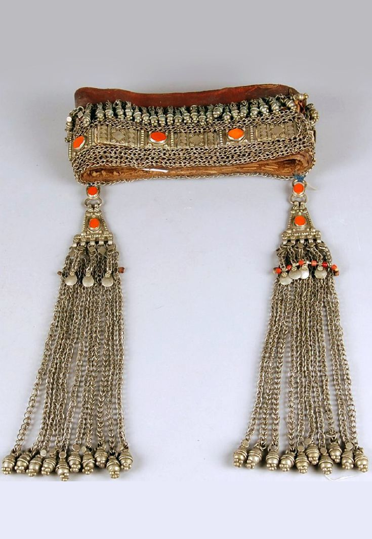 South Yemen | Woman's headdress; silver with orange glass inset beads. The long pendants are attached with blue cotton (possibly not part of the original piece) | ca. 1950s