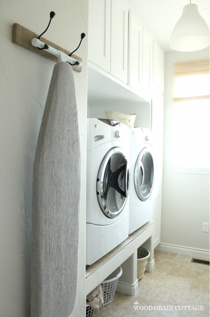 Hanging Laundry Room Rack | The Wood Grain Cottage - raised washer & dryer with space under for storage