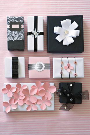 Ideas for wrapping presents; pretty pink paper flowers or black and white stylish gift wrapping.