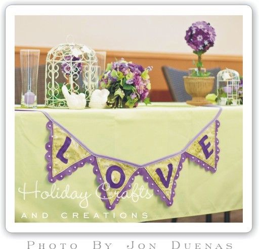 diy wedding decorations. I like the idea of having the garland on the front of the tablecloth.