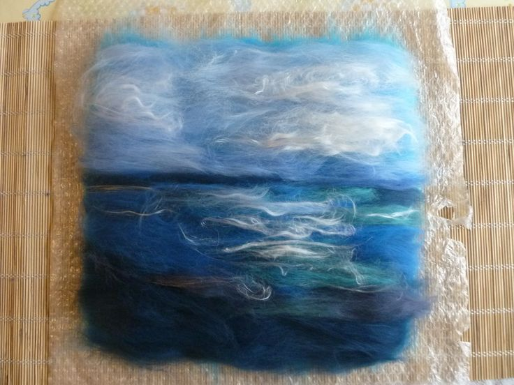 A little seascape, fibres all laid out and ready to felt / full.  You can see more photos of this item and other works in progress by LittleDeb on my Facebook page: LittleDebFelts