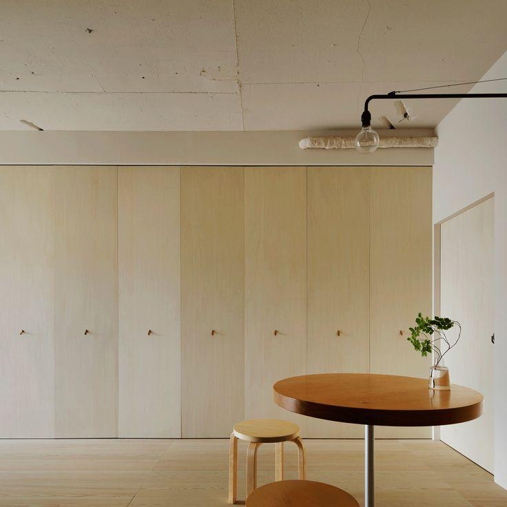 Tokyo apartment by Minorpoet features kitchen hidden behind folding doors