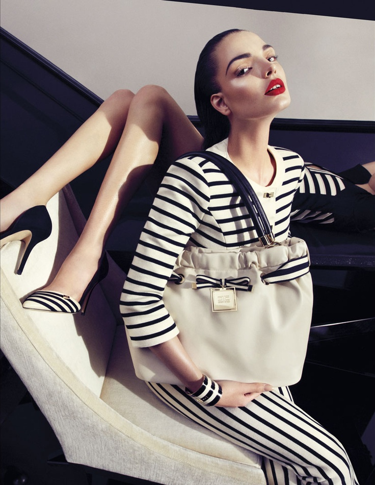 Refined black & cream stripes are enjoined to powerful and opulent details. Carola Remer and Anne Marwald ooze pure seduction and luxury navy chic style lensed by Camilla Akrans.