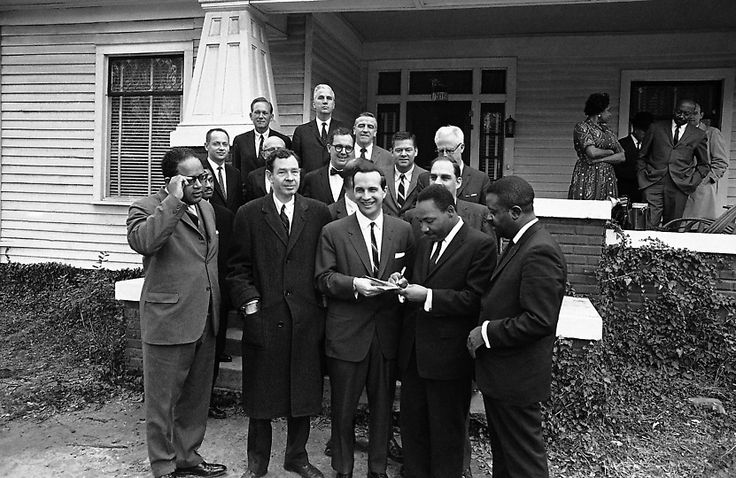February 5: 1965: Dr. Martin Luther King Jr. shown with a congressional delegation after his release from jail on this day in Selma, Alabama. The group, headed by Rep. Charles Diggs, D-Mich, left, came to Selma to observe the racial situation first hand. At right is Rev. Ralph Abernathy, an associate of King who was jailed with him. (AP Photo)