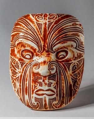 Parata Kaitiaki (small) Alert and watchful, a kaitiaki or guardian watching over you  A parata is a human-style face, usually with moko (facial tattoo). It represents a significant ancestor or influencial person. These images are used to show the whakapapa (lineage) of places and tribal groups. As such, this work can represent anyone significant to you. This beautiful work is cast in ceramics from an original wood carving and fired with a range of colourful glazes.
