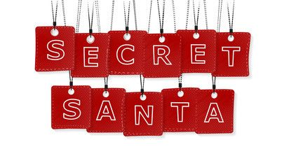 Secret Santa text with black and red labels isolated on white background