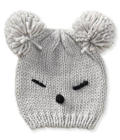 """Can't """"bear"""" another dreary day? Better grab our Koala Pom Beanie to cheer yourself up! The cozy knit beanie features yarn details to resemble a koala face, while two chunky pom-poms form the ears. This goofy look will definitely lift your spirits 'til the sun comes out again.<br><br>Style: 9903. Imported.<br><br>100% acrylic.<br>Machine wash/dry flat."""