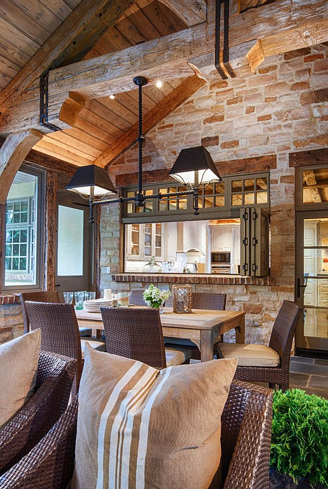 ranch style luxury home | pass-through window by Loewen is practical and architectural.
