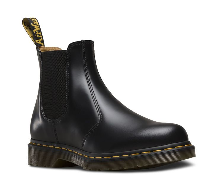 While the first Dr. Martens 2976 Chelsea boot was produced in the early '70s, the original style has Victorian origins. Farmers loved the sure fit and easy-on, easy-off elastic ankle gusset - kickass style was just an unexpected side effect. These days, the 2976 Chelsea boot is a slick, uncompromisingly fashion-forward look for both sexes. Part of our 'Lost Archives' collection, this boot is made with the classic Dr. Martens Smooth leather, a lightly textured, highly durable leath...