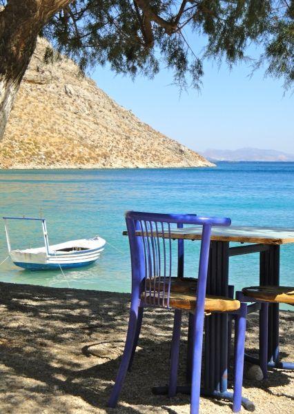 Akti beach: a table on the water. Kalymnos. Greece