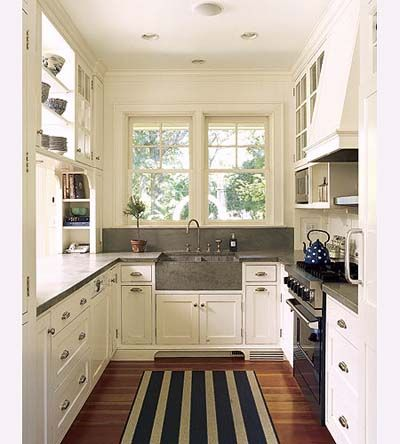 another galley kitchen i love for the condo....soapstone (?) sink, backsplash & counters. , cupboards, built-ins, shelves in front of windows.