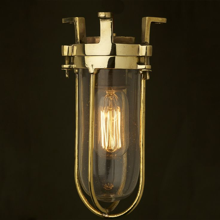 Fixed Ships caged glass ceiling light 24O V, 6A with brass cage, brass lampholder E27 fitting and Edison style bulb.