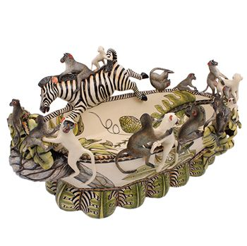 Tebogo Ndlovu's hand-coiled Bronco Bowl is packed full of humour and fun. You cannot help giggling when you look at the bucking zebra, which has just kicked a monkey in his behind. Around them a troop of monkeys tumble and play in a frivolous pursuit of fun. It's clear to see that Tebogo enjoyed sculpting this action- and comedy-filled Zambezi masterwork