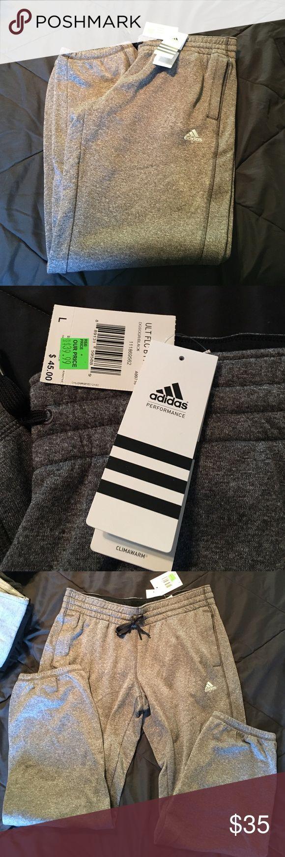 Adidas grey fleece jogger pants size large Adidas grey fleece jogger pants size large. NWT. Never worn. Pockets on both sides. Elastic waist with ties. And elastic at bottom of pant. Adidas Pants