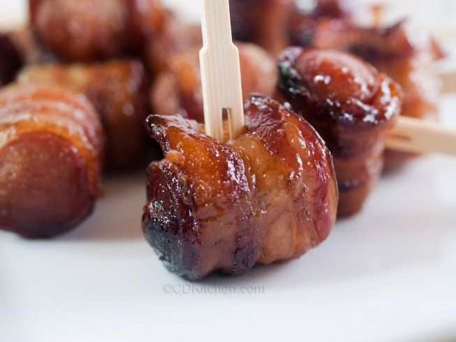 "Bacon Wrapped Dogs - CDKitchen.com - Hot dog pieces (or ""lil' smokies"") are wrapped in bacon, coated in brown sugar, and then slow cooked until the bacon caramelizes. The ultimate party food!"