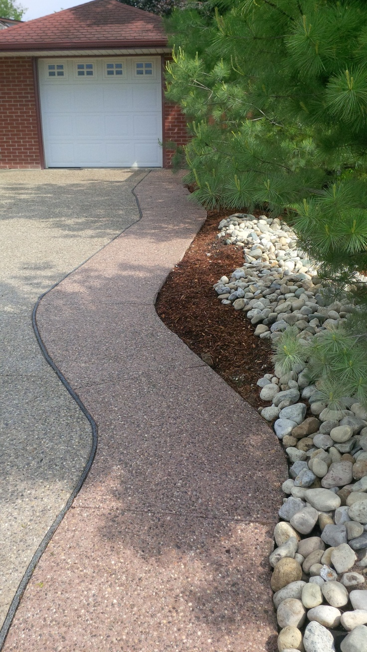 Exposed Aggregate Driveway, Some River Stone And Landscaping. Burgundy  Colour, Acorn Colour.