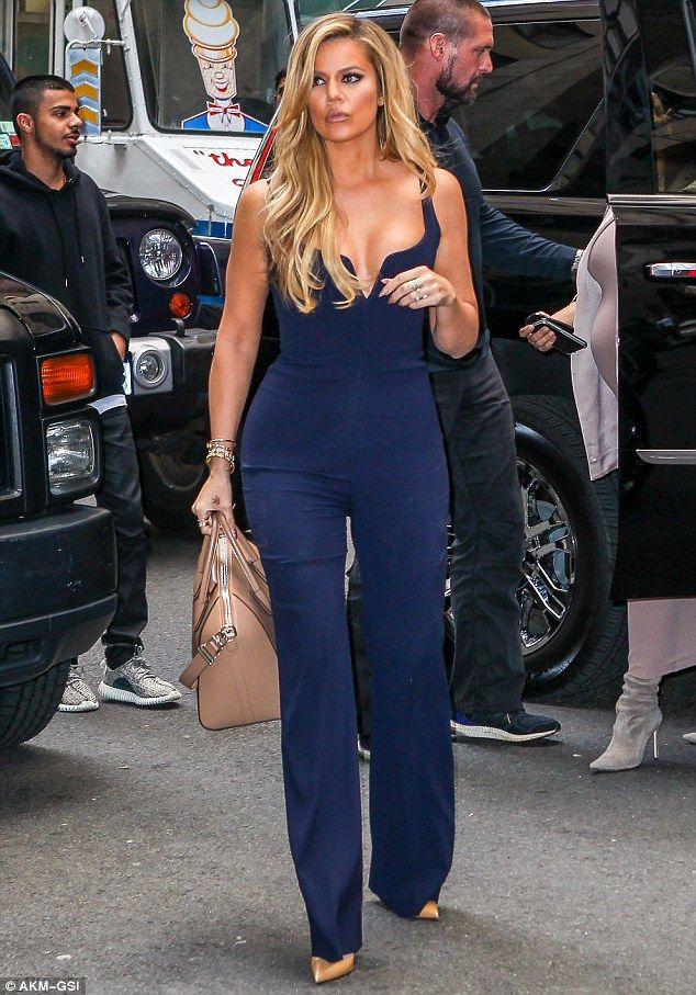 Amazing results: Khloe showed off the results of her hard work in a gorgeous blue jumpsuit while out with her sisters in New York City on Monday
