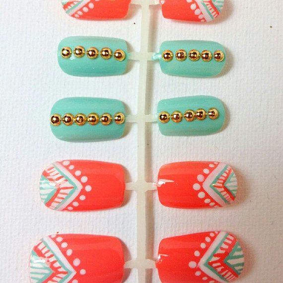 Coral and mint tribal print nail art design with round gold studs