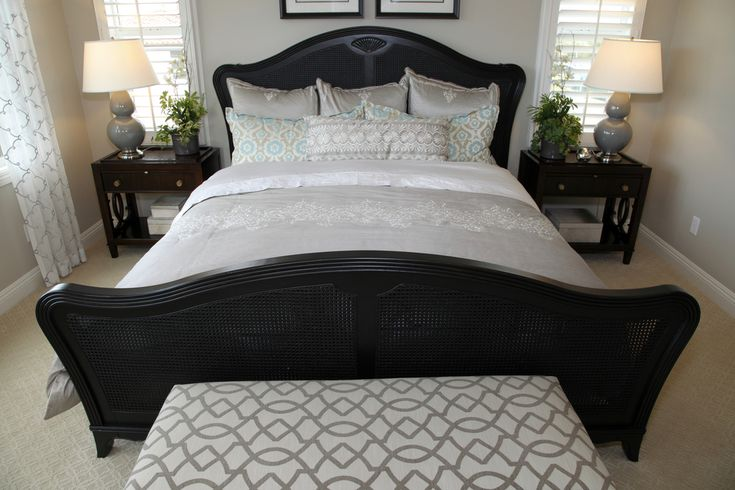 Small Bedroom With Black Wicker Bed Frame Featuring A
