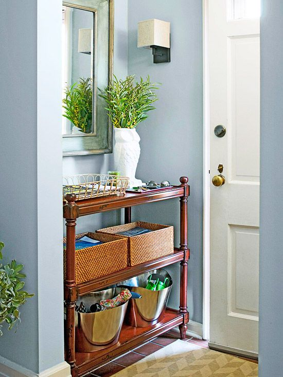 A wooden shelving unit slips perfectly into a slender alcove just inside the front door: http://www.bhg.com/home-improvement/storage/friendly-and-functional-entries/?socsrc=bhgpin041514fitsjustright&page=13