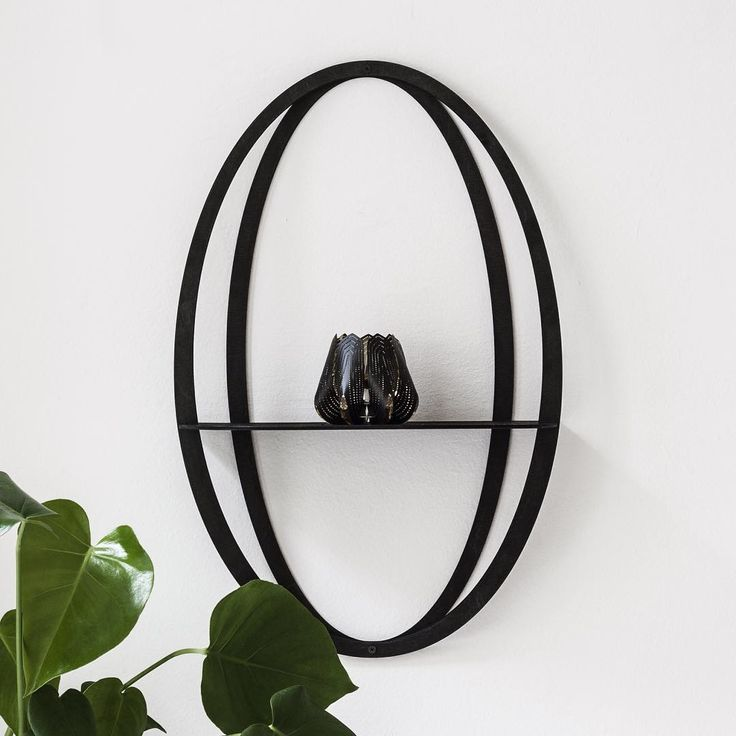 Halo is a beautiful three-dimensional shelf where small interior objects can be displayed with grace.