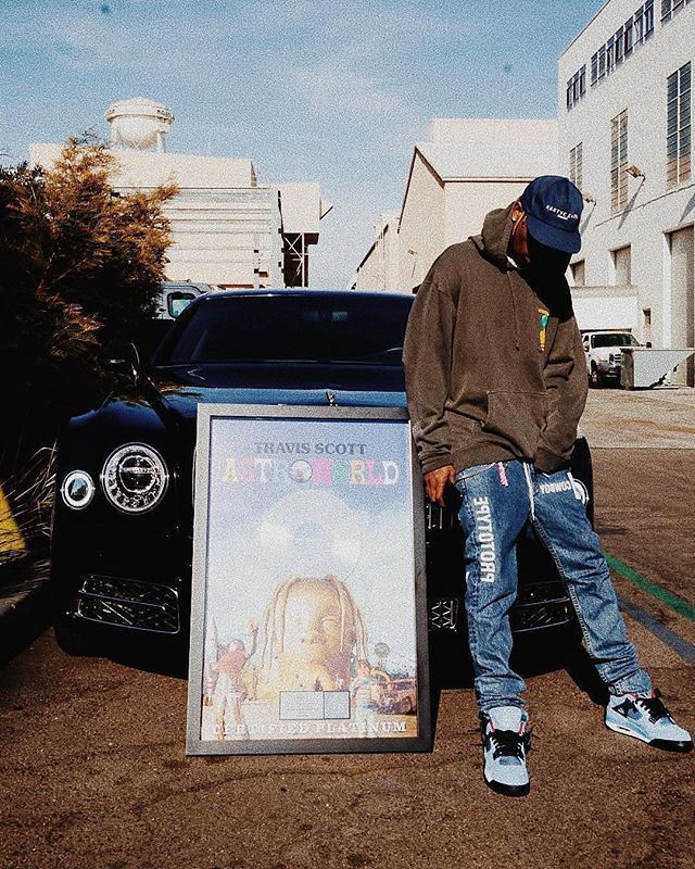 a51f509387a Certified Platinum  travisscott  TravisScott leans on his  Bentleymotors  with his  ASTROWORLD platinum plaque while wearing a  Astroworld hoodie ...