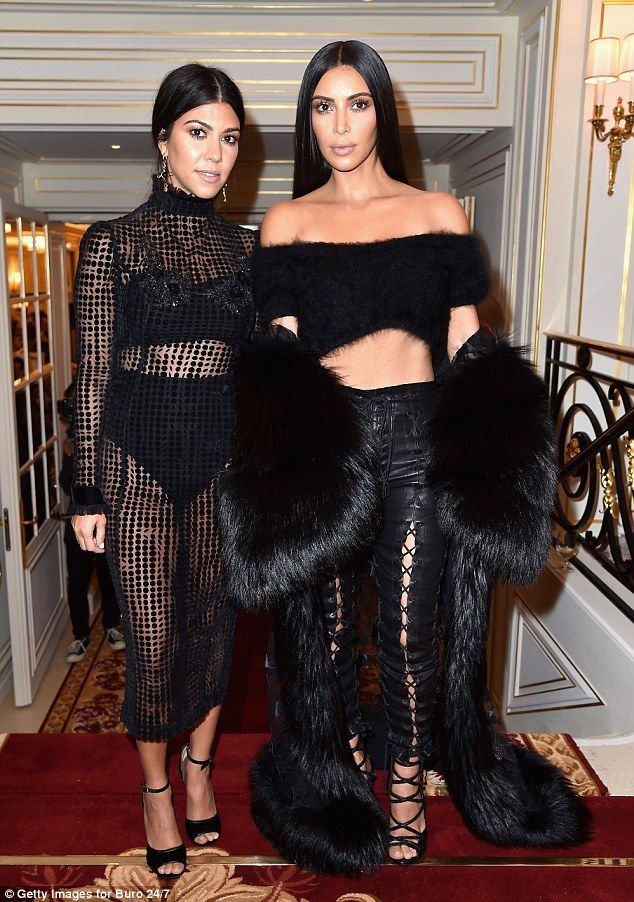 Sister sister: Kim and Kourtney Kardashian dressed to impress at the Buro 24/7 Fashion Forward Initiative at Paris Fashion Week in the French capital on Friday
