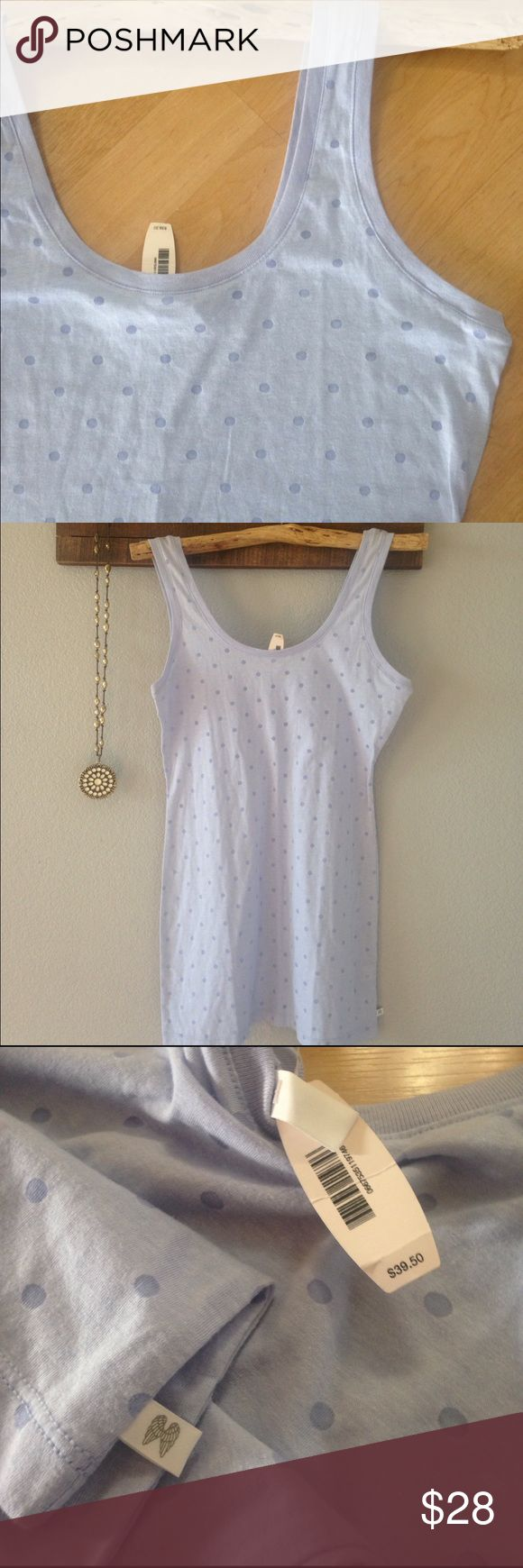 """NWT Victoria's Secret Polka dot tunic swim cover NWT Victoria's Secret Polka dot tunic swim suit bikini 👙 cover up. Soft lavender with (peek-a-boo) mesh polka dots! 57% cotton & 43% polyester. Can also be worn as a tunic with leggings or a night gown for bed! Versatile piece. Length is 31"""". Ships same day of purchase. Victoria's Secret Swim Coverups"""