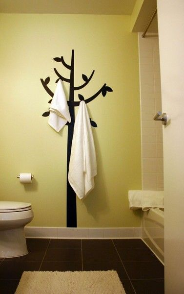 paint the tree then add hooks for storage. Totally doing this in the bathroom!