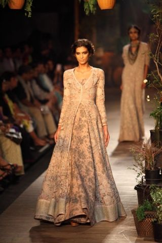 Sabyasachi Mukherjee for PCJ DELHI COUTURE WEEK 2013 - I love this collection as its different from his traditional designs bold colours. His introduction of floral prints, lace, sequins, crochet and coral shades this season are simply beautiful