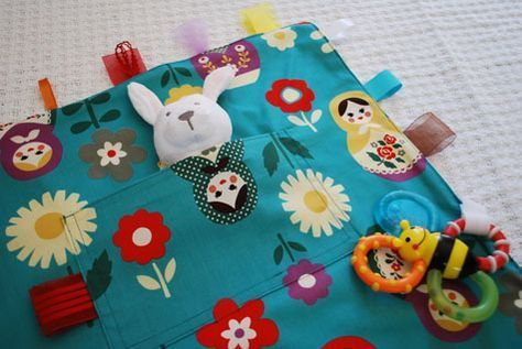Merriment :: Kid's Travel Toy Blanket with Velcro Loops and Ribbon Tags free DIY tutorial and pattern template craft project for Merriment Design by Kathy Beymer at MerrimentDesign.com
