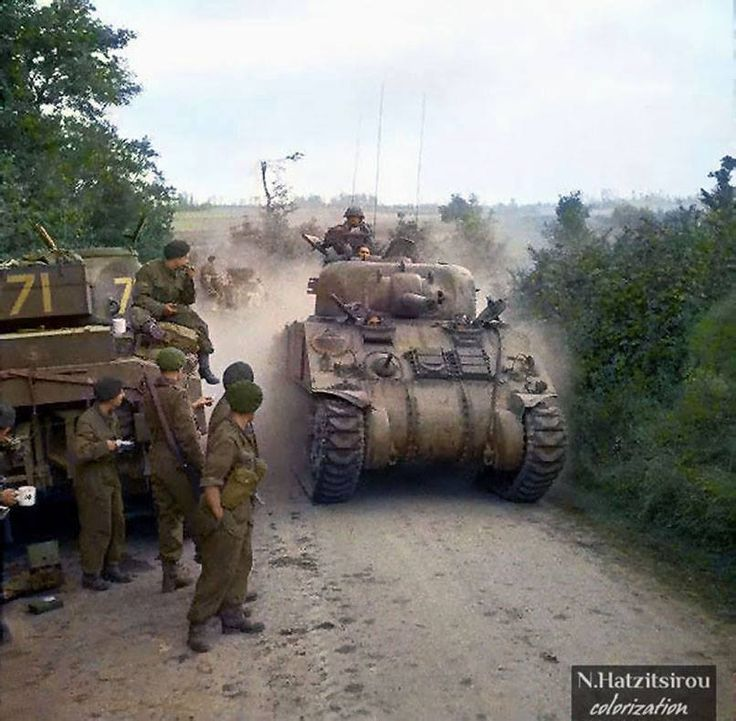 Sherman tanks of 33rd Armoured Brigade, supporting 3rd Infantry Division, moving forward near Lebisey Wood for Operation 'Charnwood', the assault on Caen, 8 July 1944.