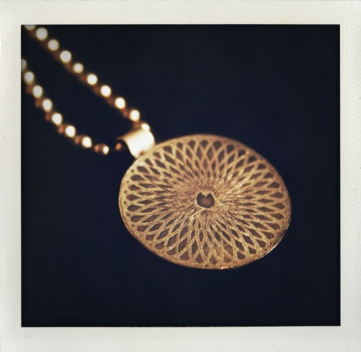 Necklace with etched pattern