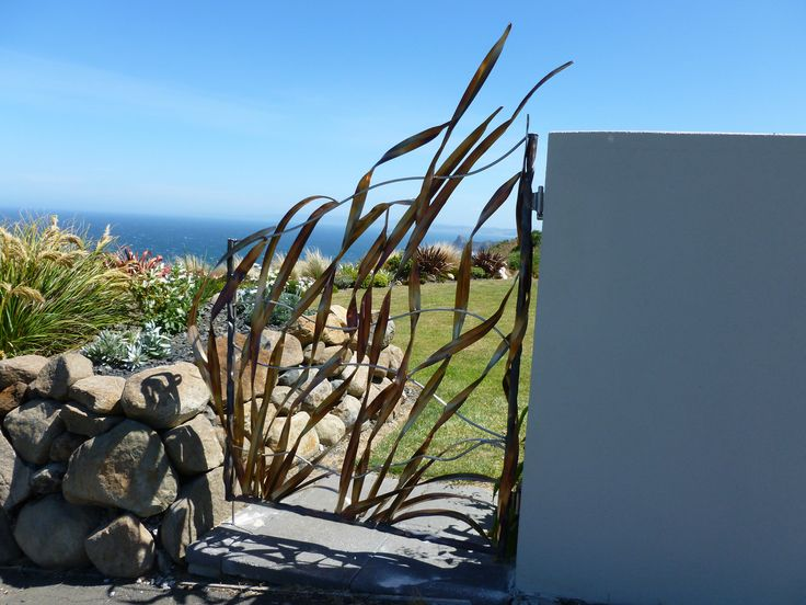 Gate made for clients on a sea cliff by Bill Clarke of Forged and Crafted  , NZ.