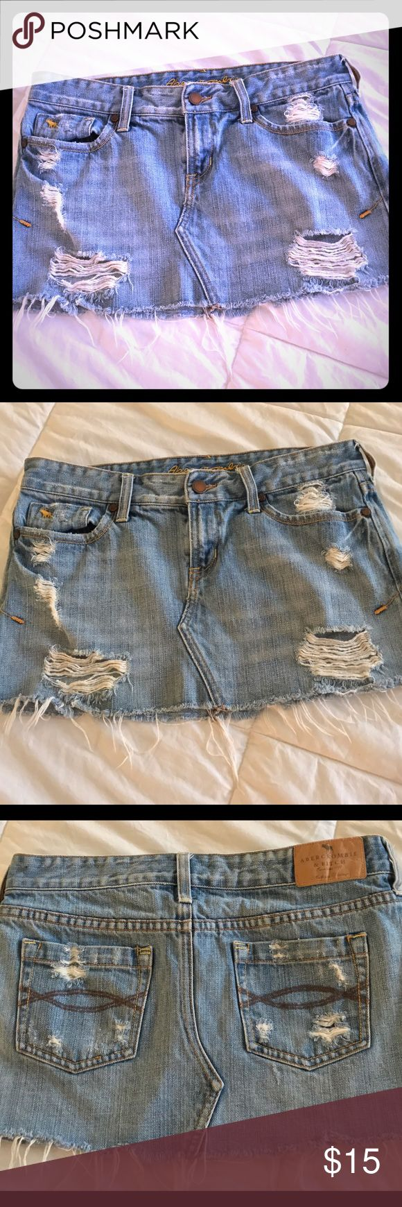 Distressed Abercrombie low waisted jean skirt Very cool low waisted mini jean skirt distressed by Abercrombie and fitch Abercrombie & Fitch Skirts Mini