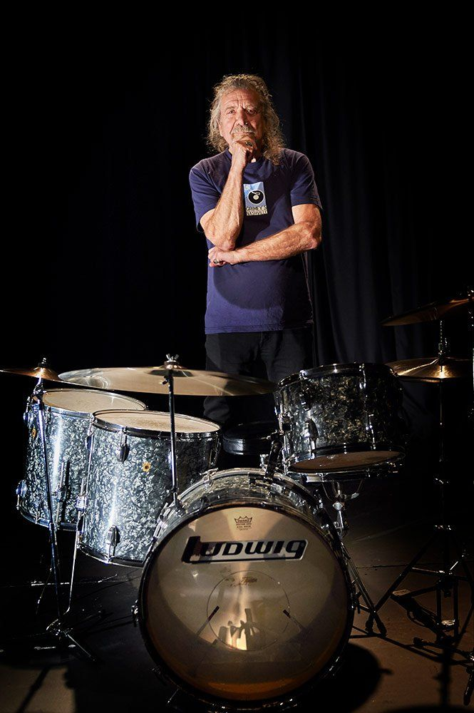 Robert Plant photographed next to a drum kit previously owned by John Bonham