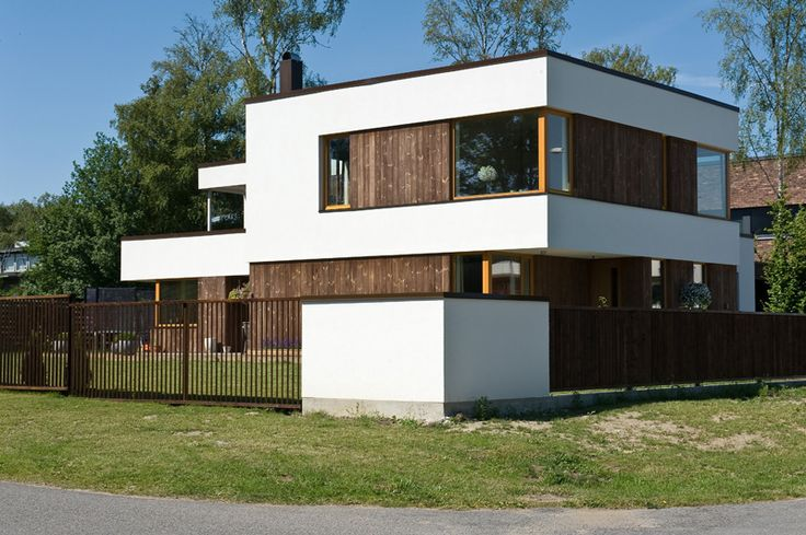 Wood and white concrete facade