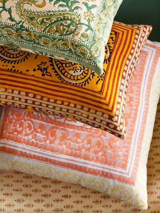 Fabric Finesse        Patterned pillows scattered throughout the room add easy-to-change hits of color. To keep costs low, these pillows were covered with repurposed bedspreads and napkins. To ensure various patterns will blend well together, make sure you choose ones with complementary colors and motifs.