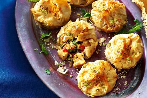 Inspired by a Moroccan classic, these flaky filo parcels are filled with aromatic spiced chicken and topped with crunchy pistachio dukkah.