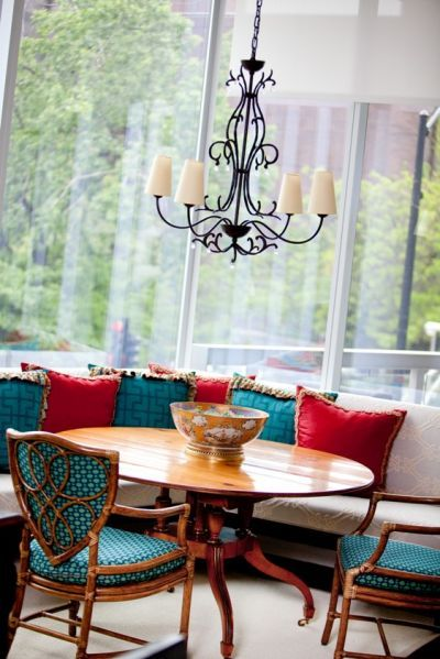 love this fairly simple chandelier with the combination of teal and red cushions.