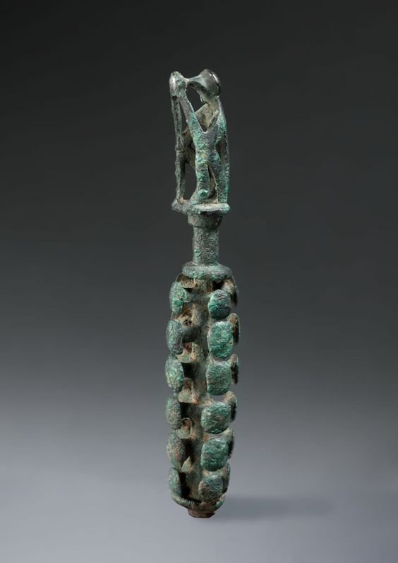 Greek bronze knobbed stem with a monkey, Geometric period, late 8th century B.C. These objects appeared in several areas of the Greek peninsula around the late 8th and early 7th century B.C. (Macedonia, Thessaly, Epirus, modern-day Albania, Boeotia, rarely in Laconia) and their meaning remains obscure even if the long accepted hypothesis that interpreted them as jug stoppers is now widely questioned, even refuted, 11 cm high. Private collection